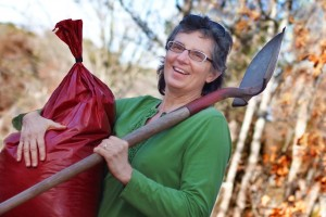 Horticulturist Carol Lundeen of Easton, MA, carries a sack of locally produced compost, the organic gardeners' secret ingredient for safe, smart, money-saving lawns and gardens.
