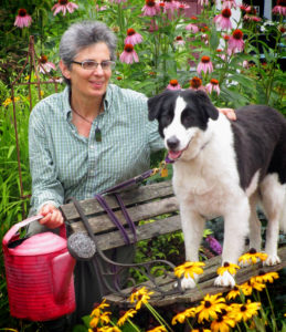 Garden-911 owner Carol Lundeen with her dog, Harper